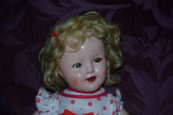 Compositon Shirley Temple doll by Ideal c 1930s.