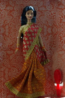 Barbie in India comes with a brush.