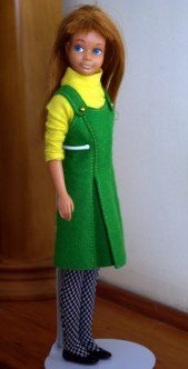 Underneath Skippers coat she has this cute pinafore dress and top.