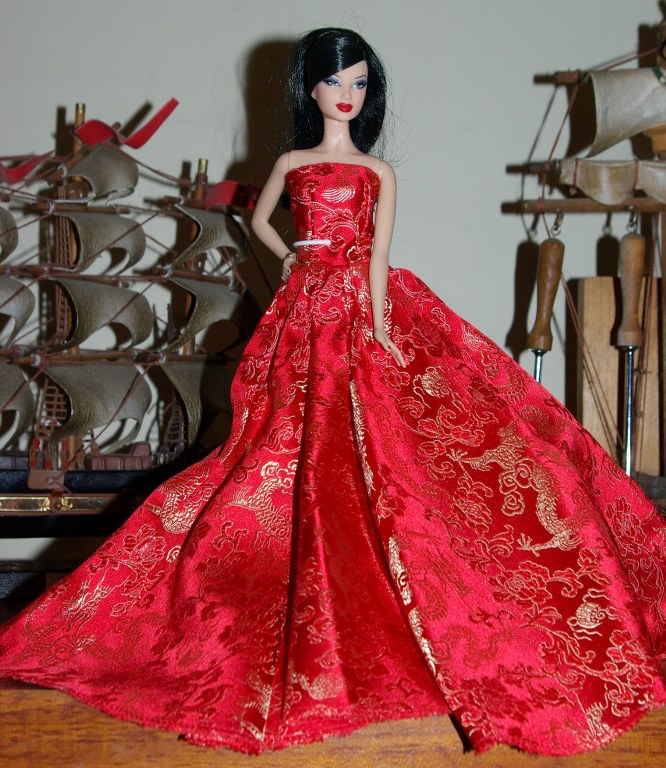 Krystyna in red strapless evening gown.