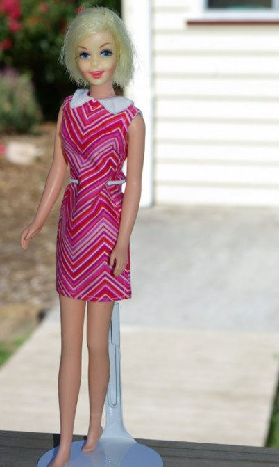 Casey in a retro style chevron patterned dress.