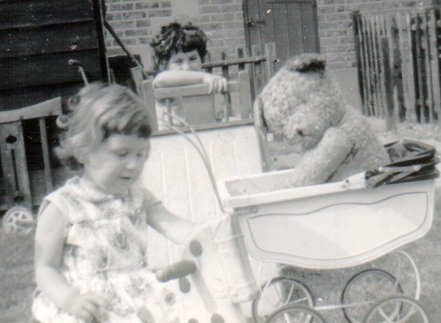 Us with Big Teddy in our old pram