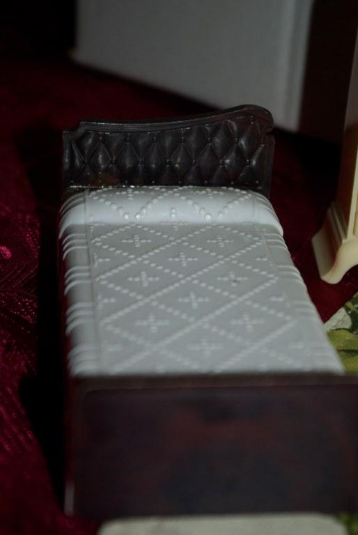 Plasco bed in hard plastic.