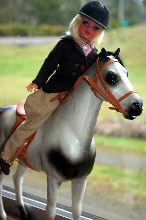Sindy astride her horse.
