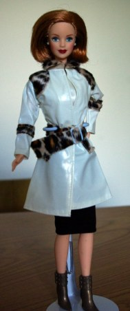 Laura in a generic raincoat.