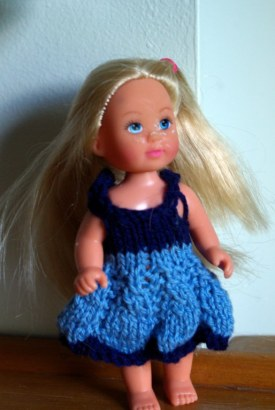 A blue knitted dress for this little Simba doll.