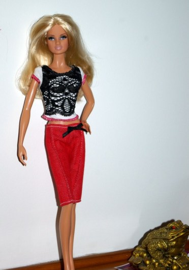 Joanne in the red crop pants and black and white top with red trim.