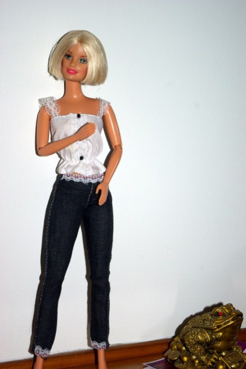 Midge in lace trimmed jeans and white blouse.