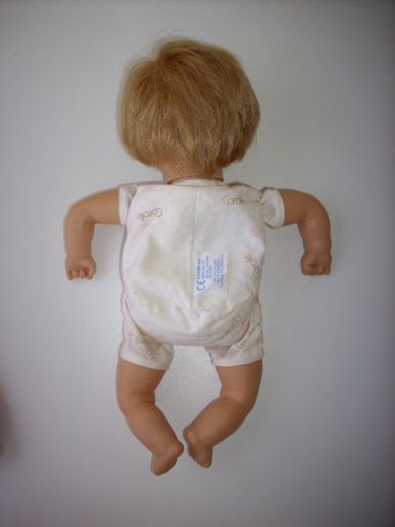 back of doll