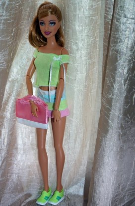 Penny in the green top and blue, pink and green skirt.