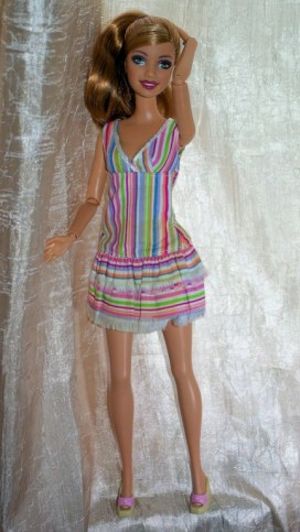 Penny in the Rainbow stripe dress and sandals.