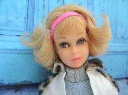 Francie with flip hair do.