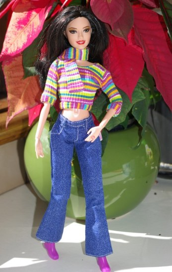 Marissa in striped top, jeans, boots and matching scarf.