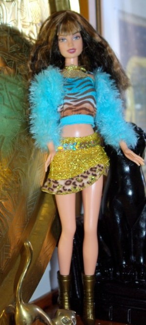 Petra wears the gold skirt, halter top and fluffy jacket