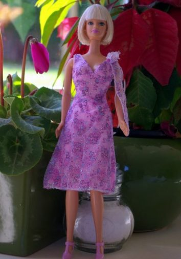 Vivienne in mauve floral dress.