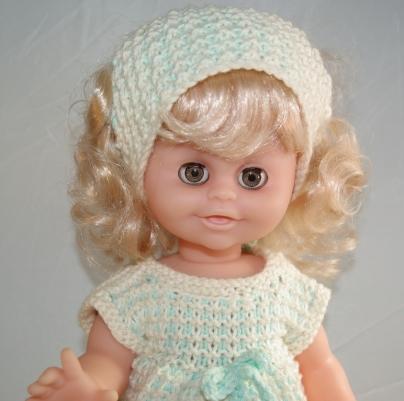 Linda with blonde hair abd brown eyes.
