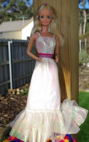 An older style Barbie with the Superstar face and bent arms.