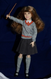 Hermione with her wand.