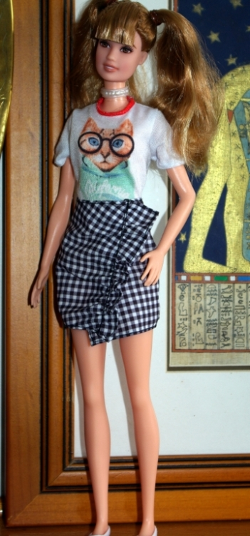 Frances in cat tee shirt and check skirt.