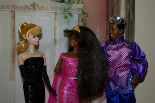 Barbie greets Princess Asha and her husband.