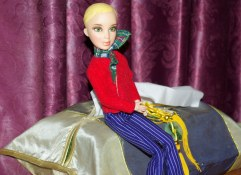 seated doll wearing Liv pants and generic top.