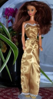 Sylvia in Barbie gold pajamas.