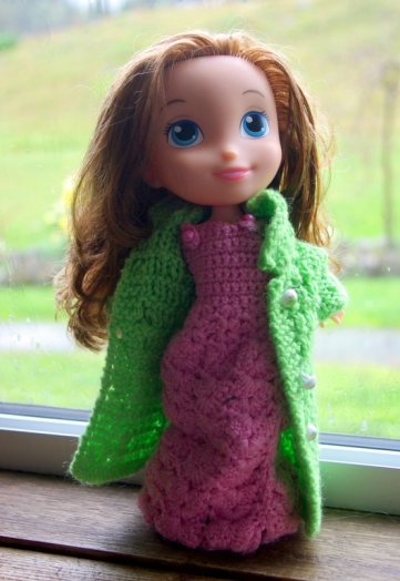 Disney Princess in hand knitted outfit.