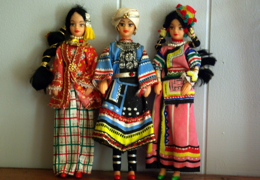 Vintage hard plastic dolls in national dress.
